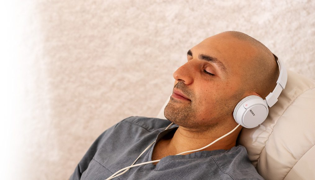 Close up of man resting as he breathes easy during a salt session.