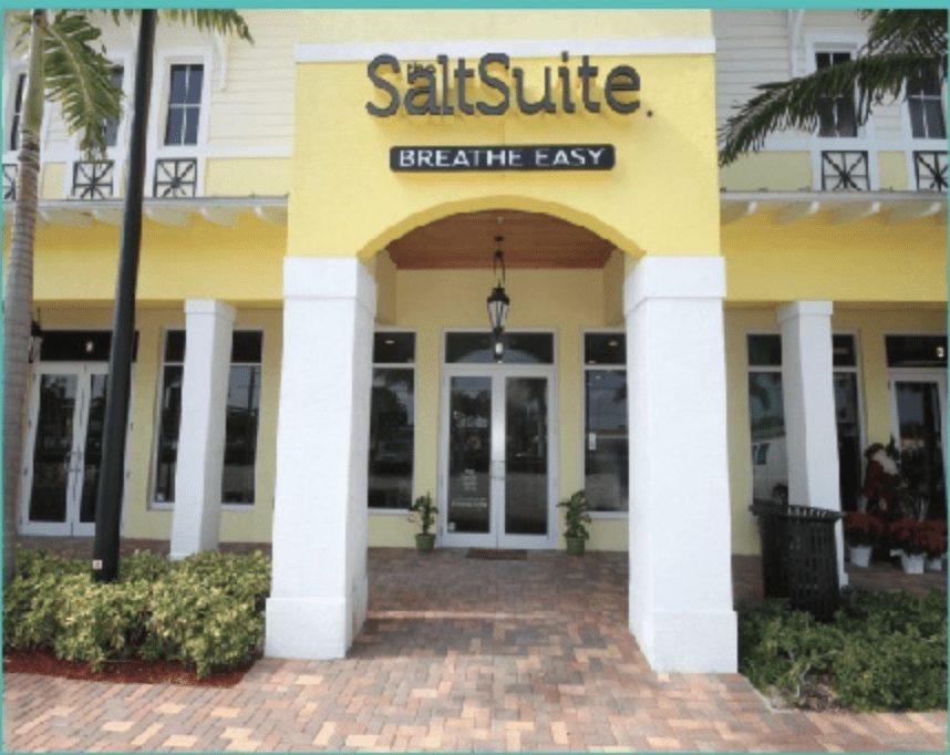 The Salt Suite yellow storefront in Del Ray, Florida.