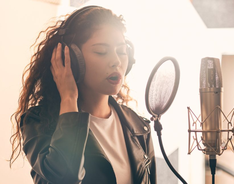Young woman in recording studio.