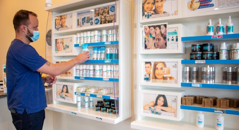 Client looking through skin care products.