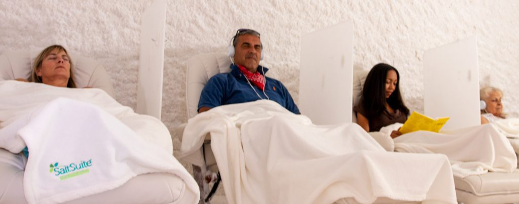 Four clients relaxing as they breath easy during a salt session.