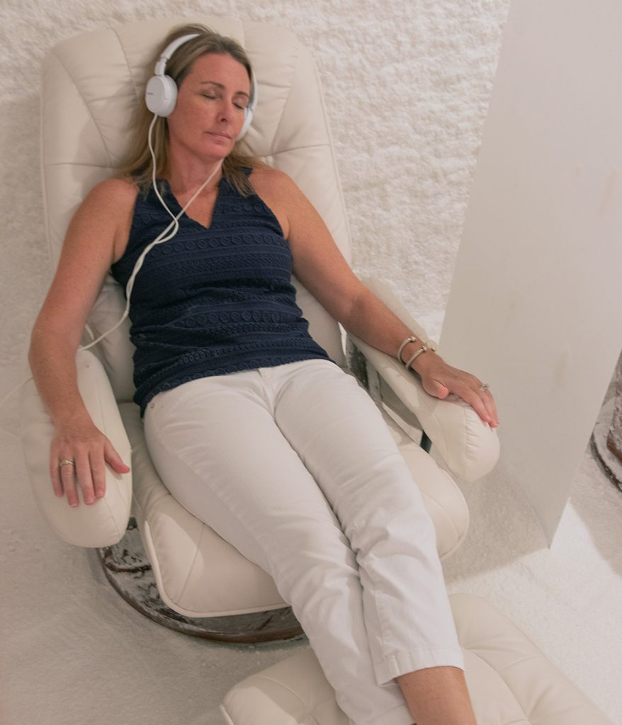 Woman with headphones relaxing of a salt therapy session at the Salt Suite.