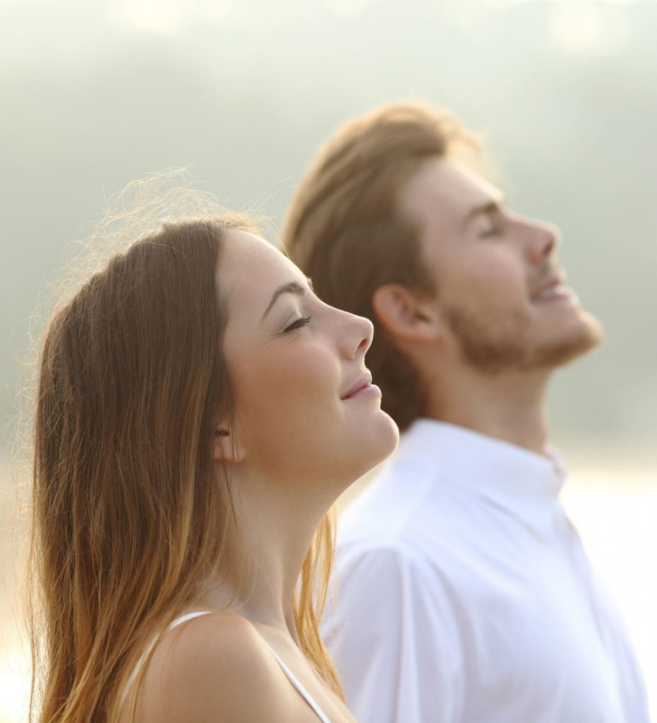 Young man and women breathing easy.